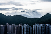 Mountains in fog behind skyscrapers of Hong Kong, Sheung Shui, New Territories, Hong Kong