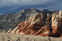 Sandstone rock formation and mountain range in desolate deserts of Red Rock Canyon, Las Vegas, Nevada, USA