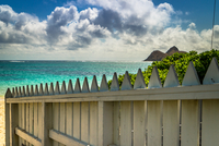 Pacific ocean under clouds, wooden fence in foreground, Lanikai Beach, Kailua, Honolulu, Hawaii, USA