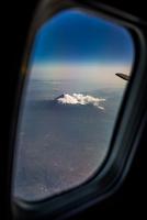 View of Fuji through plane window, Honsiu, Japan