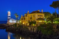 Illuminated seaside hotel during dusk, Cascais, Portugal