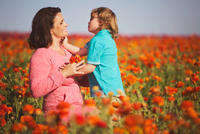 Mother and son (4-5) in field of tulips, Los Angeles, California, USA
