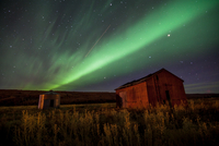 Green aurora over countryside, Alberta, Canada