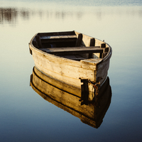 Abandoned boat on water