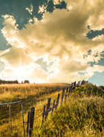Rural landscape with fence and clouds, California, USA
