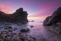Sunrise over rocky coastline, Malaysia