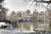 Pond in front of Crystal Palace in Buen Retiro Park in winter, Madrid, Spain