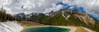 Lake, trees, grass and mountains under cloudy sky, Fulpmes, Tyrol, Austria