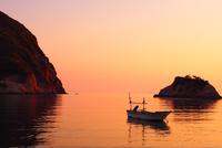 Bot on sea at twilight