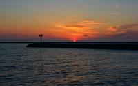 Sunset over Lake Michigan and pier silhouette, Muskegon, Michigan, USA