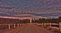 Altocumulus clouds over empty road, Ontario, Canada