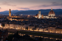 Illuminated cityscape and cathedral, Florence, Italy