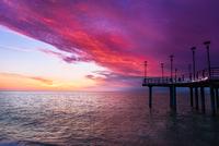 Sunset over sea and jetty, Georgia, USA