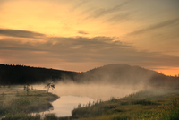 Hills and lake in mist, Canada