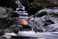 Sunset reflection on waterfall