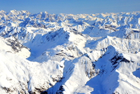 Aerial view of snow-capped mountain range under clear sky, Alaska, USA