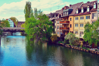 Tenement houses by river, Nurnberg, Germany