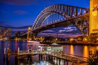 Illuminated bridge above river, Australia