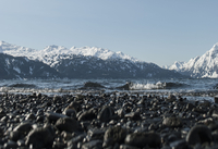 Beach with pebbles against mountains, Valdez, Alaska, USA
