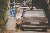 Two old vehicles and Greece flag, Greece