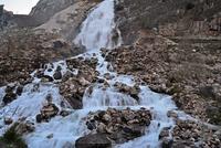 Waterfall cascade flowing through rocks