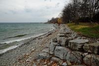Gravel on Lake Ontario coast in moody sky, Oakville, Ontario, Canada