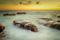 Rock formations in South Atlantic Ocean at sunset, Cape Town, Western Cape Province, South Africa