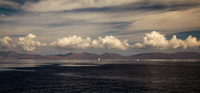 Seascape with clouds and remote mountains, Turkey