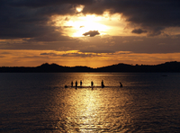 Silhouette of fishermen in water at sunset, Para Pare, Sulawesi, Indonesia