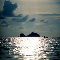 Silhouette of island and fisherman on sea, Ko Samui, Thailand