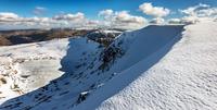 Clouds over snowy landscape, Cumbria, England, UK