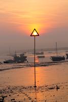 Sun in sign, Mersea Island, Essex, England, UK