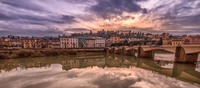 Sunset over Florence old town, Arno river in foreground, Tuscany, Italy