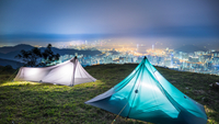 Illuminated tents on Tai Mo Shan, Victoria Harbor, Hong Kong, China