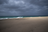 Storm over sea and sandy beach