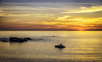 Seascape with boat at sunset, Cape Town, South Africa
