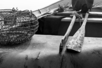 Close up of boat interior with oars and fishing cage, Vila Cha, Portugal