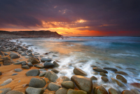 Rocky beach at Sunset, Capo Pecora, Sardinia, Italy