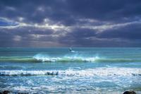 Silhouette of windsurfer in ocean