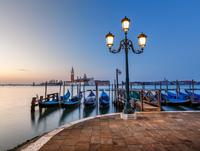 Gondolas and san Giorgio Maggi ore church, Venice, Italy