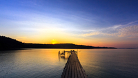 Sunset over wooden pier and sea, Thailand