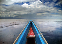 Seascape under dramatic sky from bow of boat, Sulawesi Utara, Indonesia