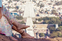 Mother and son (6-7) sitting and looking at view of city, Thiruvannamalai, Tamilnadu, India