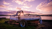 Sunset over river shore and boat, Arthurstown, Ireland
