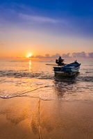 Seascape with boat at sunrise, Thailand