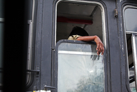 Mans hand hanging through open window in bus, Hyderabad, India