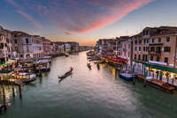 Town by canal at sunset, Venice, Italy