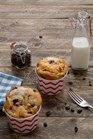 Milk, coffee, and muffins on wooden table
