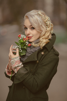 Young blonde woman with bunch of flowers, Moscow, Russia