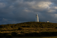 Lighthouse under heavy clouds, Bruny Island, Tasmania, Australia